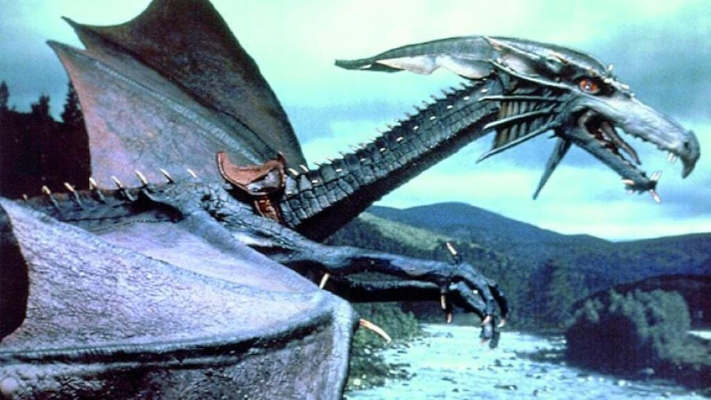 A promotional image of Smirkenorff the Dragon with broader wings set against a mountainous backdrop.