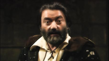 Treguard the Dungeon Master, played by Hugo Myatt. As seen in Series 6 of Knightmare (1992).