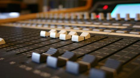 Audio mixing desk. Photo by Wim Coenen for FreeImages.