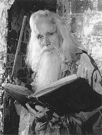 A 1988 character shot of Merlin with book (John Woodnutt).