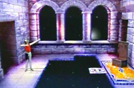 Knightmare Series 3 Team 12. Chris pretends to fire a bow to evoke a step in Merlin's chamber.