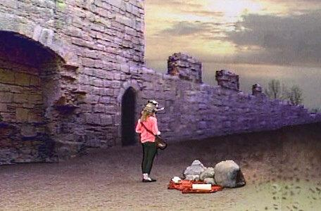 Knightmare Series 5 Team 3. Sarah finds clues by a castle wall.