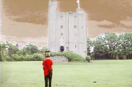 Knightmare Series 5 Team 4. Ben in a field with the gate tower in the distance.
