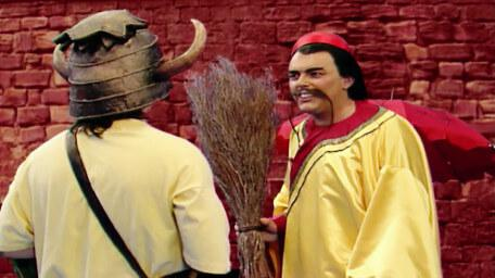 An inline image of the trader, Ah Wok (Mark Knight) in Series 6 of Knightmare.