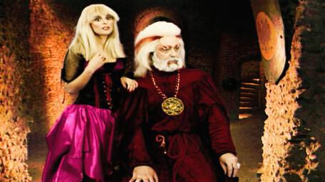Hordriss the Confuser, played by Clifford Norgate, as seen in Series 6 of Knightmare (1992) - with daughter Sidriss (Iona Kennedy).