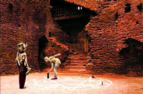 Knightmare Series 6 Team 2. Sumayya watches Elita performing a ritual in a stone courtyard.
