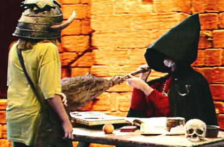 Knightmare Series 6 Team 6. Hordriss disguised as a witch pokes a broomstick at the dungeoneer.
