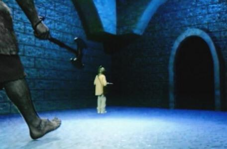 Knightmare Series 8 Team 4. A huge troll strides in as Michael reaches the corner of a blue chamber.